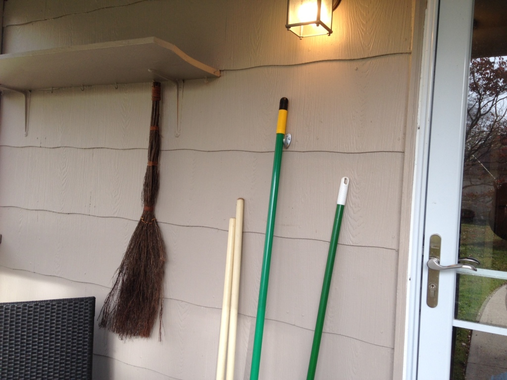 Trader Joe's Cinnamon Broom hanging out with our shovels- Look out winter!
